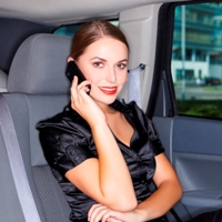 Portrait of beautiful business woman inside the limo car