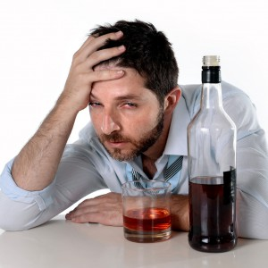 drunk business man wasted drinking whiskey in alcoholism